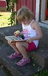 Child Enjoying Reading on Island of Kökar, Åland, Finland