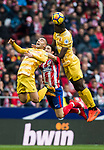 Sime Vrsaljko (C) of Atletico de Madrid competes for the ball with Michael Olunga Ogada (R) and Borja Garcia Freire of Girona FC during the La Liga 2017-18 match between Atletico de Madrid and Girona FC at Wanda Metropolitano on 20 January 2018 in Madrid, Spain. Photo by Diego Gonzalez / Power Sport Images
