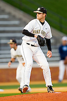 Starting pitcher Austin Stadler #9 of the Wake Forest Demon Deacons in action against the North Carolina Tar Heels at Gene Hooks Field on March 11, 2011 in Winston-Salem, North Carolina.  Photo by Brian Westerholt / Four Seam Images