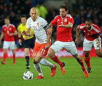 (L-R) Arjen Robben of Netherlands against Joe Allen of Wales during the Wales v Netherlands  International Friendly, at Cardiff City Stadium, Cardiff, Wales, United Kingdom, 13 November 2015.