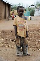 KENYA Turkana Region, refugee camp Kakuma, where 80.000 refugees from Somali, Ethiopia, South Sudan receive shelter and food from UNHCR, small boy in broken clothes / KENIA Fluechtlingslager Kakuma in der Turkana Region , hier werden ca. 80.000 Fluechtlinge aus Somalia Sudan Aethiopien u.a. vom UNHCR versorgt