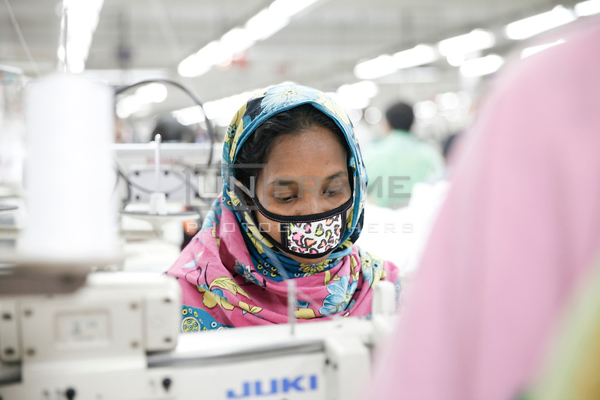 Bangladeshi female workers work at a garments factory in gazipur, near Dhaka, Bnagladesh
