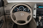 Steering wheel view of a 2010 Toyota Sienna CE 8 Passenger