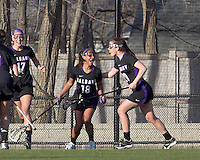 University at Albany midfielder Allie Phelan (18) and University at Albany attacker Jodi Battaglia (20) celebrate late game goal. University at Albany defeated Boston College, 11-10, at Newton Campus Field, on March 30, 2011.