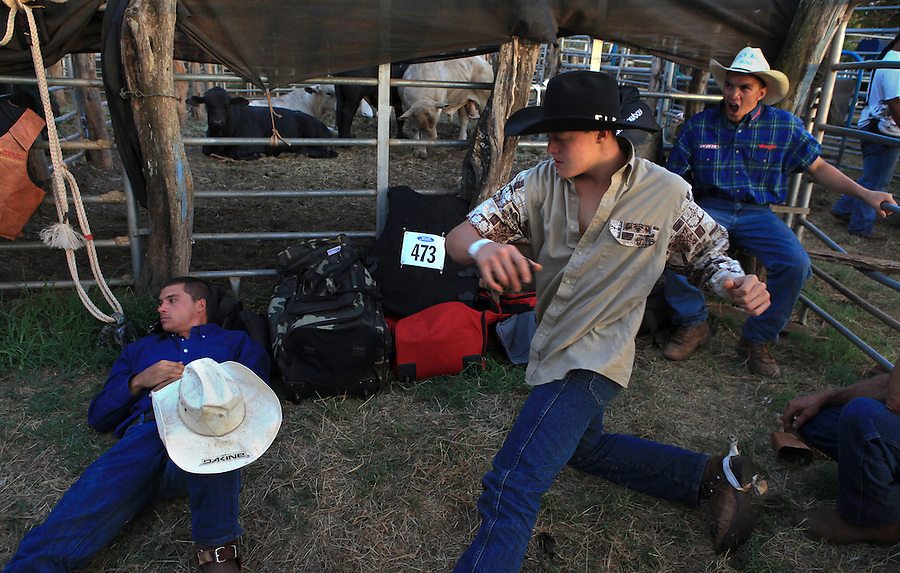 Young bull riders prepare for their bull riding event at the 4th of July Makawao Rodeo which is held annually at the Oskie Rice Arena in Olinda, upcountry Maui.  The rodeo is the largest rodeo in Hawaii, typically attracting more than 4000 spectators, and the prize money brings daring bull riders from Maui as well as neighboring islands.
