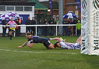 Joseph Atkinson of London Scottish Football Club scores a try despite a tackle from Callum Wilson of Rotherham Titans during the Greene King IPA Championship match between London Scottish Football Club and Rotherham Titans at Richmond Athletic Ground, Richmond, United Kingdom on 1 January 2017. Photo by Alan  Stanford.
