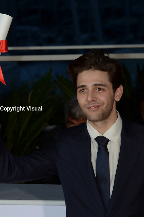 Director Xavier Dolan poses after being awarded The Grand Prix for the movie 'Just the end of the world' during the Palme D'Or Winner Photocall during the 69th annual Cannes Film Festival at the Palais des Festivals on May 22, 2016 in Cannes, France.