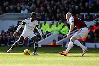 Pictured L-R: Nathan Dyer of Swansea against James Collins of West Ham. 01 February 2014<br /> Re: Barclay's Premier League, West Ham United v Swansea City FC at Boleyn Ground, London.