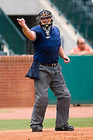 Home plate umpire Bryan Dormaier makes a strike call during a South Atlantic League game between the Kannapolis Intimidators and the Greensboro Grasshoppers at NewBridge Bank Park June 20, 2009 in Greensboro, North Carolina. (Photo by Brian Westerholt / Four Seam Images)