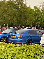 """Pictured: The car meet at the Tesco carpark in Culverhouse Cross near Cardiff, Wales, UK. Sunday 09 May 2021<br /> Re: Hundreds of people gathered in approximately 100 cars on Sunday night, at the Tesco supermarket car park in Culverhouse Cross near Cardiff, Wale, UK.<br /> Officers who called to the mass gathering at about 10pm were met with """"hostility"""" according to South Wales Police.<br /> The gathering took place at the Resco car park and then moved to the car parks of Halfords and The Range on Newport Roa, where cars were being driven in an """"anti-social"""" manner.<br /> Mass gatherings are illegal under coronavirus rules.<br /> CCTV footage is being used to identify people."""