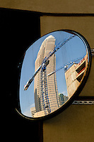 Cranes and Bank of America tower are reflected in a mirror.High rise construction workers reshape Charlotte as they construct new skyscrapers downtown. Photos taken as part of a story package on crane construction.