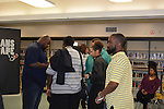 The Houston Texans Ambassadors stayed around after their presentation to sign autographs and mingle with students.