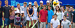 Twins Bob and Mike Bryan, and Karolina and Kristyna Pliskova pose with fans and twins at the Freedoms vs. Explorers WTT match in Villanova, PA on July 16, 2012