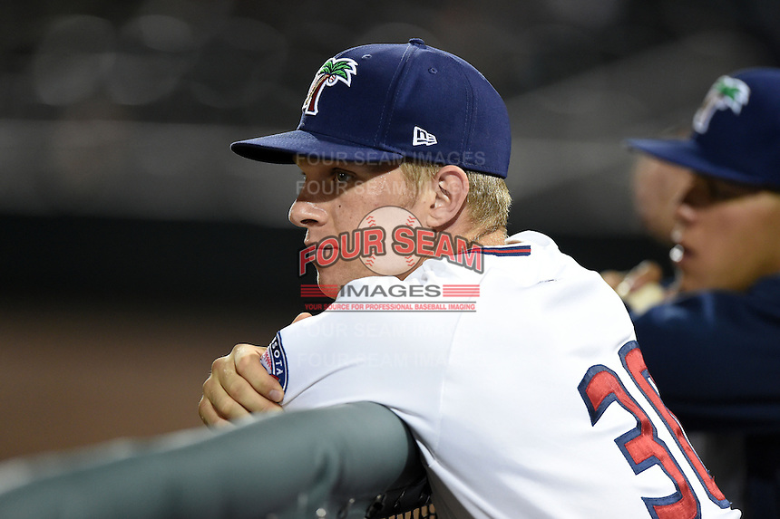 Fort Myers Miracle catcher Stuart Turner (30) watches the game in the dugout during a game against the St. Lucie Mets on April 18, 2014 at Hammond Stadium in Fort Myers, Florida.  St. Lucie defeated Fort Myers 15-9.  (Mike Janes/Four Seam Images)