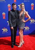 SANTA MONICA, USA. June 16, 2019: Jason Wahler & Ashley Slack at the 2019 MTV Movie & TV Awards at Barker Hangar, Santa Monica.<br /> Picture: Paul Smith/Featureflash