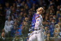 Chicago Cubs catcher David Ross (3) looks for a foul ball in the second inning during Game 5 of the Major League Baseball World Series against the Cleveland Indians on October 30, 2016 at Wrigley Field in Chicago, Illinois.  Image was distorted due to a pain of glass.  (Mike Janes/Four Seam Images)