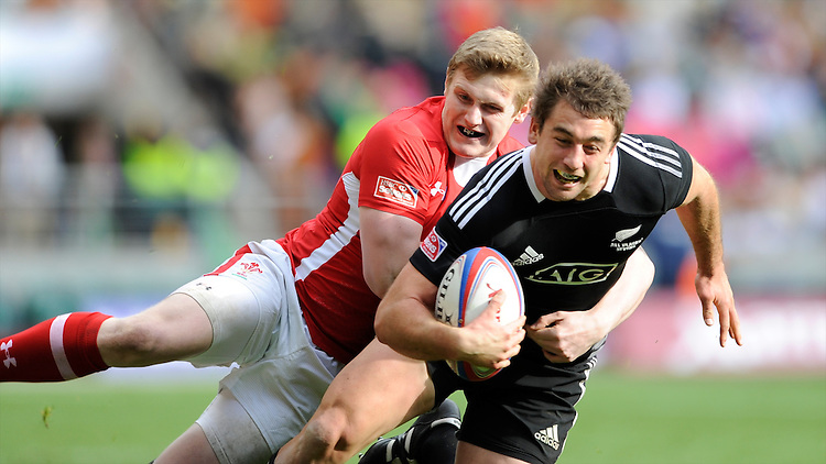 Kurt Baker of New Zealand is tackled by Dafydd Howells of Wales during the iRB Marriott London Sevens at Twickenham on Saturday 11th May 2013 (Photo by Rob Munro)