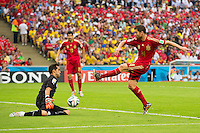 Claudio Bravo of Chile saves a shot by Xabi Alonso of Spain