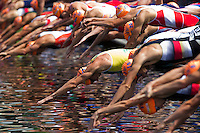 24 JUN 2012 - KITZBUEHEL, AUT - Competitors dive into the water at the start of the swim at the elite men's 2012 World Triathlon Series round in Schwarzsee, Kitzbuehel, Austria .(PHOTO (C) 2012 NIGEL FARROW