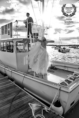 A wedding couple on a yacht at The American Yacht Club in Rye, New York.