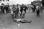 Scottish football fan 'dead drunk', other Scottish fans leave Wembley Stadium, at the end of the match. 1980s Britain...
