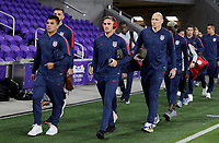 ORLANDO, FL - NOVEMBER 15: Nick Lima #12, Tyler Boyd #21 and Brad Guzan #1 of the United States walks onto the field during a game between Canada and USMNT at Exploria Stadium on November 15, 2019 in Orlando, Florida.