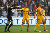 Jordan Storey of Preston North End (C) congratulates Declan Rudd of Preston North End (L) for saving the Swansea penalty during the Sky Bet Championship match between Swansea City and Preston North End at the Liberty Stadium, Swansea, Wales, UK. Saturday 11 August 2018