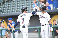 Northwest Arkansas Naturals' Bobby Witt Jr. gets congratulated by M.J. Melendez after a first inning score against the Arkansas Travelers's Tuesday July 13, 2021 at Arvest Ballpark in Springdale. Visit nwaonline.com/21000714Daily/ and nwadg.com/photo. (NWA Democrat-Gazette/J.T. Wampler)