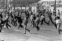 Jovenes se enfrentan con la policia en la quinta protesta contra la dictadura.<br /> Santiago Chile Septiembre 1983<br /> <br /> Forty years ago, on September 11, 1973, a military coup led by General Augusto Pinochet toppled the democratic socialist government of Chile. President Salvador Allende was killed during the  attack to seize  La Moneda presidential palace.  In the aftermath of the coup, a quarter of a million people were detained for their political beliefs, 3000 were killed or disappeared and many thousands were tortured.<br /> Some years later in 1981, while Pinochet ruled Chile with iron fist, a young photographer called Juan Carlos Caceres started to freelance in the streets of Santiago and the poblaciones or poor outskirts, showing the growing resistance against the dictatorship. For the next 10 years Caceres photographed every single protest and social movement fighting for the restoration of democracy. He knew that his camera was his only weapon, he knew that his fate was to register the daily violence and leave his images for the History.<br /> In this days Caceres is working to rescue and organize his collection of images in the project Imagenes de la Resistencia   . With support of some Chilean official institutions, thousands of negatives are digitalized and organized to set up the more complete visual heritage of this  violent period of Chile´s history.