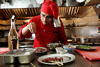 """Chef Javier Degabriel prepares a Kangaroo steak in the kitchen of Eight Mile Creek in the Soho district of Manhattan in New York City. The restaurant has battled state legislators for the right to serve Kangaroo after it was banned for being an"""" endangered species"""".  Pic by Trevor Collens. 2 Sept 2010."""
