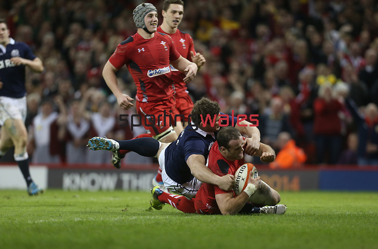 Wales centre Jamie Roberts dives over to score despite the efforts of Ross Ford to stop him.<br /> RBS 6 Nations 2014<br /> Wales v Scotland<br /> Millennium Stadium<br /> <br /> 15.03.14<br /> <br /> ©Steve Pope-SPORTINGWALES