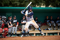 Lasell Lasers catcher Wes Hurty (12) at bat during the first game of a doubleheader against the Edgewood Eagles on March 14, 2016 at Terry Park in Fort Myers, Florida.  Edgewood defeated Lasell 9-7.  (Mike Janes/Four Seam Images)