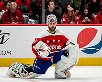 WASHINGTON, DC - JANUARY 31: Braden Holtby #70 of the Washington Capitals  rests while the ice is cleaned during a game between New York Islanders and Washington Capitals at Capital One Arena on January 31, 2020 in Washington, DC.