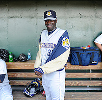 Pitcher Rafael De Paula (37) of the Charleston River Dogs takes off his jacket in the dugout before a game against the Greenville Drive on Saturday, April 6, 2013, at Fluor Field at the West End in Greenville, South Carolina. De Paula, a free agent from the Dominican Republic, threw 4.1 innings, striking out 11 and giving up five hits and two runs. Charleston won Game 1 of a doubleheader, 6-2. De Paula did not figure in the decision. (Tom Priddy/Four Seam Images)