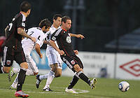 Kurt Mosink)#6 of D.C. United sends a pass away from Calen Carr#3 and Marco Pappa#16 of the Chicago Fire during a second round match of the Carolina Challenge on March 9 2011 at Blackbaud Stadium, in Charleston, South Carolina. D.C. United won 1-0.