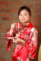 Model Released photo of a 21 year old asian (Chinese )  drinking green tea<br /> <br /> in Montreal, Canada<br /> <br /> photo : Roussel  - Images Distribution