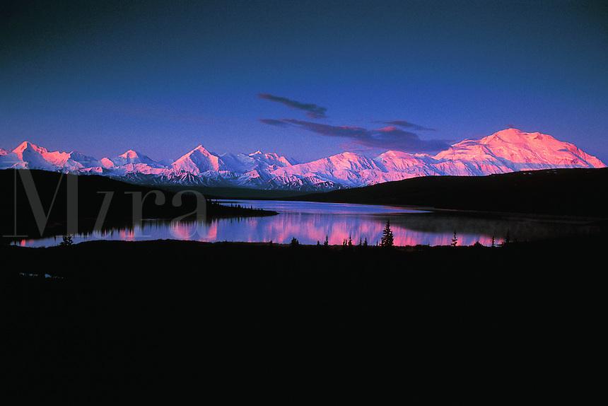 Mount McKinley with alpenglow at sunsetreflected on Lake Wonder. Denali National Park, Alaska.