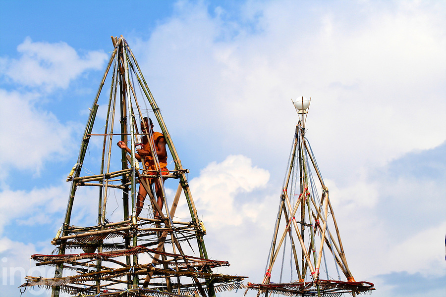 Monks building new temple at Tonle Sap Lake in Cambodia