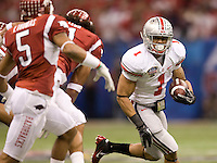 Daniel Herron of Ohio State runs the ball away from Arkansas defenders during 77th Annual Allstate Sugar Bowl Classic at Louisiana Superdome in New Orleans, Louisiana on January 4th, 2011.  Ohio State defeated Arkansas, 31-26.