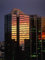 Sunset Reflecting on Modern Glass & Steel Skyscraper Building, Downtown Honolulu, Oahu, Hawaii, USA.