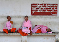 Nuns wait at a railway station Rangoon, Burma, Nov 2008.