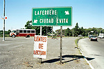 """A road traffic sign for Ciudad Evita, this sprawling pleasant garden suburb of is twenty minutes by car from the heart of Buenos Aires. It was Eva PeronÕs dream that the descamisados  the """"shirtless ones"""" should have good quality and affordable housing. The building of Ciudad Evita was started during her lifetime, and carried on after her death fifty years ago."""