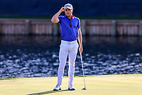 14th March 2021; Ponte Vedra Beach, Florida, USA;  Justin Thomas of the United States reacts after sinking a putt on the 18th hole during the final round of THE PLAYERS Championship on March 14, 2021 at TPC Sawgrass Stadium Course in Ponte Vedra Beach, Fl.