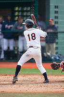 Justin Novak (18) of the Virginia Cavaliers at bat against the Hartford Hawks at The Ripken Experience on February 27, 2015 in Myrtle Beach, South Carolina.  The Cavaliers defeated the Hawks 5-1.  (Brian Westerholt/Four Seam Images)