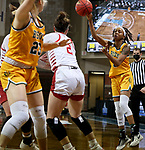 SIOUX FALLS, SD - MARCH 8: Reneya Hopkins #0 of the North Dakota State Bison passes the ball to a teammate against the South Dakota Coyotes during the Summit League Basketball Tournament at the Sanford Pentagon in Sioux Falls, SD. (Photo by Dave Eggen/Inertia)