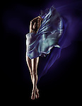 Sensual surreal photo of a beautiful naked woman with flowing blue cloth wrapping her nude body and fluttering like wings on black background Image © MaximImages, License at https://www.maximimages.com