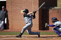 Michael Stellato (10) of the Bryant Bulldogs follows through on his swing against the High Point Panthers at Williard Stadium on February 21, 2021 in  Winston-Salem, North Carolina. The Panthers defeated the Bulldogs 3-2. (Brian Westerholt/Four Seam Images)