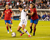 HOUSTON, TX - FEBRUARY 03: Carli Lloyd #10 of the USA attacks with the ball and is defended by Fabiola Sanchez #5 of Costa Rica during a game between Costa Rica and USWNT at BBVA Stadium on February 03, 2020 in Houston, Texas.