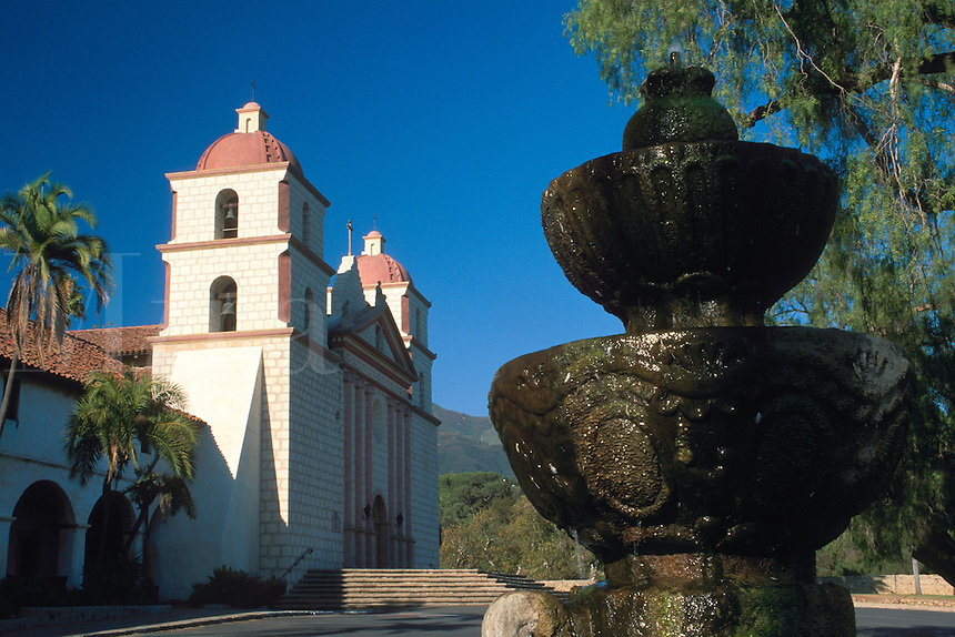 Stone Water fountain in front of Mission Santa Barbara, Spanish adobe architecture building, built 1786, Mission Park, Santa Barbara, California.
