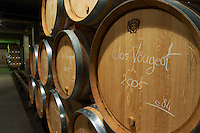 The modern barrel aging cellar with barriques pieces with maturing wine, a barrel butt inscribed in chalk with Clos Vougeot Grand Cru 2005, Maison Louis Jadot, Beaune Côte Cote d Or Bourgogne Burgundy Burgundian France French Europe European